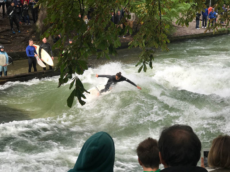 surfers in english garden munich