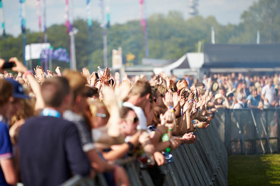 Tomorrowland Crowds Enjoying Themselves At Outdoor Music Festival